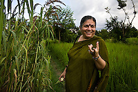 Dr. Vandana Shiva, founder of Navdanya Foundation and Bijavidyapeeth (College of Seeds) in Dehradun, Uttarakhand, India, talks about the benefits of millet as she walks through her farm on 5th September 2009. Dr. Vandana Shiva is a physicist turned environmentalist who campaigns against genetically modified food and teaches farmers to rely on indigenous farming methods.. .Photo by Suzanne Lee / For The National