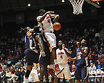 "Ole Miss' Reginald Buckner (23) vs.East Tennessee State's Kinard Gadsden-Gilliard (35) and East Tennessee State's Hunter Harris (20) at the C.M. ""Tad"" Smith Coliseum in Oxford, Miss. on Saturday, December 14, 2012. Mississippi won 77-55 to improve to 7-1. (AP Photo/Oxford Eagle, Bruce Newman).."