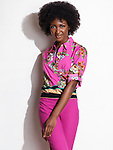 Beautiful smiling young african american woman wearing pink floral top and pants. Fashion photo isolated on white background.