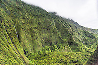 An aerial view of waterfalls flowing down the cliffs on Mt. Wai'ale'ale, Kaua'i