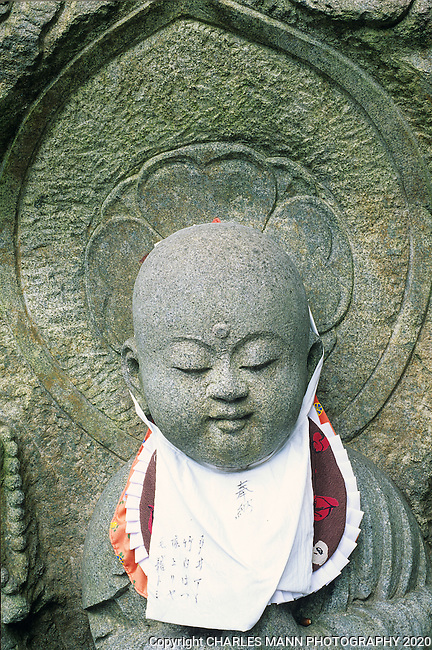 A serene Buddha image carved from stone and embellished with cloth adornments seems especially paceful.