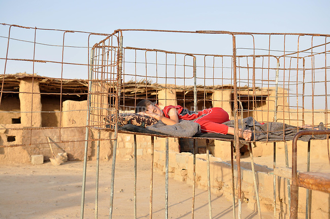 DOWDA, IRAQ:  Kamal sleeps outside in the early morning...Iraqi forces decimated the Dowda area in Germian during the 1988 Anfal genocidal campaign against the Kurds.  Daily life continues is this extremely harsh part of Iraq...Photo by Aram Karim/Metrography