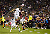 Eddie Lewis midfielder of the LA Galaxy heads a ball past Colorado Rapids defender Wells Thompson. The Colorado Rapids defeated the LA Galaxy 3-1 at Home Depot Center stadium in Carson, California on Saturday October 16, 2010.