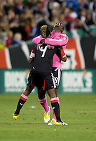 Bill Hamid (28) of D.C. United celebrates with teammate Brandon McDonald (4) after the game at RFK Stadium in Washington, DC.  D.C. United defeated the Columbus Crew, 3-2.