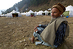 Following an October 8, 2005, earthquake, a displaced man sits in a tent city outside Balakot. The quake measured 7.6 on the Richter scale and killed more than 74,000 people in northern Pakistan.