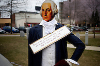 A George Washington cutout stands with a message reading &quot;First we need a Department of Peace. If we are able to develop expertise only in war, that is what we shall have,&quot; at the Occupy New Hampshire and Occupy the Primary gathering in Veterans Memorial Park in Manchester, New Hampshire on Jan. 7, 2012.  The New Hampshire GOP presidential primary is on Jan. 10.