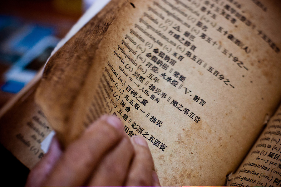 Alfredo Pong Chang, 72, learned Spanish from this Chinese-Spanish language dictionary. He is one of thirteen residents who live at Residencia del Anciano Chino, a state-run residential home for aging Chinese immigrants..