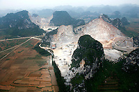 Stone pits cut away into the mountainous area of Wuming near Nanning. /Felix Features