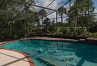 DELRAY BEACH, FL - OCTOBER 05: Despite bright blue skies, residents have begun preparations by tossing furniture in pool before a potential direct hit from category 4 hurricane Matthew in Florida. Credit: Andrew Patron/Big Shots Photo/MediaPunch