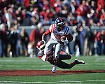 Ole Miss running back Jeff Scott (3) is tackled by Arkansas safety Rohan Gaines (26) at War Memorial Stadium in Little Rock, Ark. on Saturday, October 27, 2012. Ole Miss won 30-27...