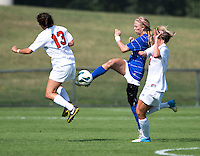Kaitlyn Kerr (5) of Duke clears the ball away from Molly Menchel (13) and Julia Roberts (8) of Virginia during the game at Klockner Stadium in Charlottesville, VA.  Virginia defeated Duke, 1-0.