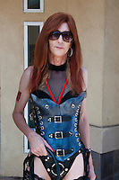 Tall Female Redhead Leather Outfit, Holding Whip, LA Pride 2010 West Hollywood, CA Parade