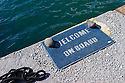 """Santorini, Greece. 05.05.2014. A doormat, bearing the legend """"Welcome on Board"""", by a mooring in the harbour, Vlychada, Santorini, Greece. Photograph © Jane Hobson."""