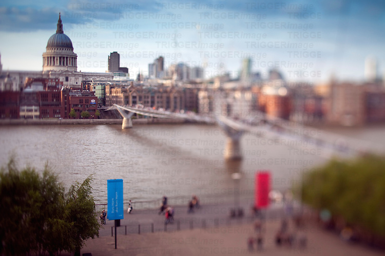 Millenium Bridge over the Thames and St Paul cathedral on the background, London, England, United Kingdom. Tilted lens used for shallow depth of field.