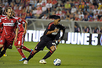 AC Milan midfielder Ronaldinho (80) dribbles away from Chicago Fire midfielder Justin Mapp (21).  AC Milan defeated the Chicago Fire 1-0 at Toyota Park in Bridgeview, IL on May 30, 2010.