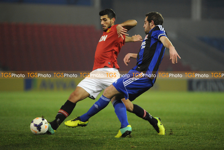 Davide Petrucci of Manchester United battles for the ball with Matthew Dolan of Middlesbrough - Manchester United Under-21 vs Middlesbrough Under-21 - Barclays Under-21 Premier League Football at Salford City Stadium, Manchester - 20/01/14 - MANDATORY CREDIT: Greig Bertram/TGSPHOTO - Self billing applies where appropriate - 0845 094 6026 - contact@tgsphoto.co.uk - NO UNPAID USE