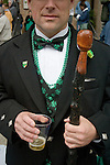 A reveler poses while escorting his mother to Savannah's St. Patrick's Day Parade.
