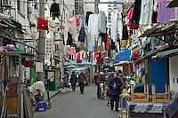Washing lines in a Shanghai street..Shanghai, February 2006.