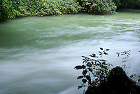 River flowing at mouth of Grutas de Lanquin caves, Alta Verapaz, Guatemala.