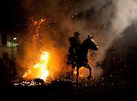 San Anton, the patron saint of animals, horses are riden through,Spain