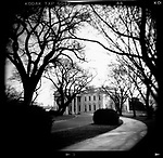General  - Pictorial..Washington DC:  The White House, surrounded by the bare, leafless trees of spring.  April, 2001
