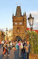 Tourists on Charles bridge in Prague. View to the Old town bridge tower