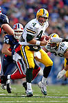 5 November 2006: Green Bay Packers quarterback Brett Favre (4) scrambles in the pocket to avoid a sack, while looking for an open receiver against the Buffalo Bills at Ralph Wilson Stadium in Orchard Park, NY. The Bills defeated the Packers 24-10. Mandatory Photo Credit: Ed Wolfstein Photo.<br />