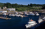 Coast Highway 101 along the Oregon Coast marina fishing boat cruises sunny afternoon Depoe Bay Oregon State USA..