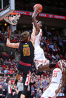 Ohio State Buckeyes forward Sam Thompson (12) puts in a dunk under pressure from Maryland Terrapins guard/forward Jake Layman (10) in the second half of the college basketball game between the Ohio State Buckeyes and the Maryland Terrapins at the Jerome Schottenstein Center in Columbus, Wednesday evening, December 4, 2013. The Ohio State Buckeyes defeated the Maryland Terrapins 76 - 60. (The Columbus Dispatch / Eamon Queeney)