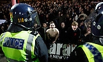 Grimsby Town 1 Lincoln City 3, 28/12/2014. Blundell Park, Football Conference. Lincoln fans celebrate at full time, behind a line of stewards and police.  Photo by Paul Thompson.