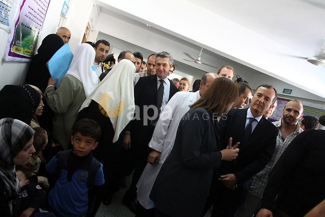 Italian Foreign Minister Franco Frattini, is accompanied by members of his delegation and security personnel as he visits the Al-Sweede United Nation's hospital in Gaza City, on 24 November 2010. Photo by Ashraf Amra