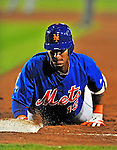 5 March 2012: New York Mets infielder Ronny Cedeno dives safely back to first during a Spring Training game against the Washington Nationals at Digital Domain Park in Port St. Lucie, Florida. The Nationals defeated the Mets 3-1 in Grapefruit League play. Mandatory Credit: Ed Wolfstein Photo