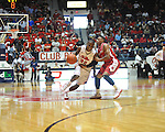 "Mississippi's Jarvis Summers (32) drives against Rutgers' Myles Mack (4) at the C.M. ""Tad"" Smith Coliseum in Oxford, Miss. on Saturday, December 1, 2012. Mississippi won 80-67. (AP Photo/Oxford Eagle, Bruce Newman).."