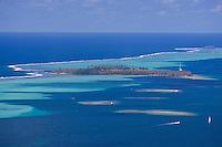View of islands, pass, and surrounding reefs from Raiatea island