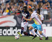 Foxborough, Massachusetts - August 20, 2016: First half action. In a Major League Soccer (MLS) match, New England Revolution (blue/white) vs Columbus Crew (yellow/white/blue), at Gillette Stadium.