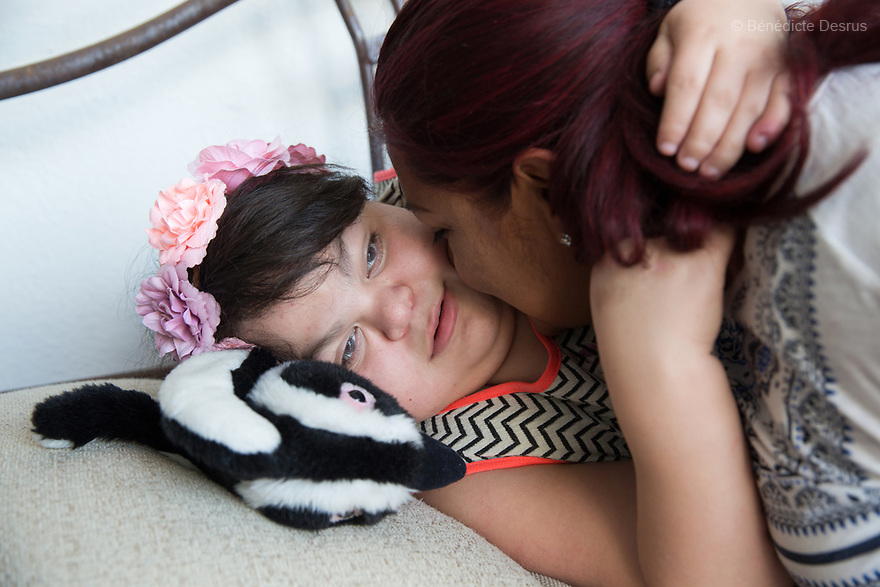 "Ana Ximena Navarro (L) is pictured with her aunt Gabriela Rios Ballesteros (R), at her home in Guadalajara, Mexico on February 22, 2017. Ximena was diagnosed as an infant with Hurler syndrome. Hurler syndrome is the most severe form of mucopolysaccharidosis type 1 (MPS1), a rare lysosomal storage disease, characterized by skeletal abnormalities, cognitive impairment, heart disease, respiratory problems, enlarged liver and spleen, characteristic facies and reduced life expectancy. Ximena was being given enzyme replacement therapy (ERT) when she was 19 months old, and she was suddenly able to eat and sleep. She is now 12, and has normal hormonal development for her age, although some mental delay, according to her father. ""Without the treatment, she would have died from all the complications — untreated, children have a very bad quality of life and typically die before they are seven"", her father says. Photo credit: Bénédicte Desrus"