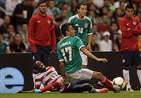 MEXICO CITY, MEXICO - AUGUST 15, 2012:  DaMarcus Beasley (17) of the USA MNT squeezes the ball away from Jesus Zavala (17) of  Mexico during an international friendly match at Azteca Stadium, in Mexico City, Mexico on August 15. USA won 1-0.