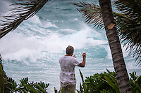 Namotu Island Resort, Nadi, Fiji (Saturday, February 20 2016): Geoff Doig (AUS) filming Tropical Cyclone Winston, a Cat 5 cyclone and described as the worse storm ever to hit Fiji has been bearing down on us all day from East. The predicted track has been changing all day but it looks like the cyclone will pass very close to the North or even pass right over the top of the island. Winds are forecast to reach in excess of 300 klm per hour. Photo: joliphotos.com