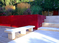 Red plastered terraced bed with white sandstone paving and hardwood cedar decking