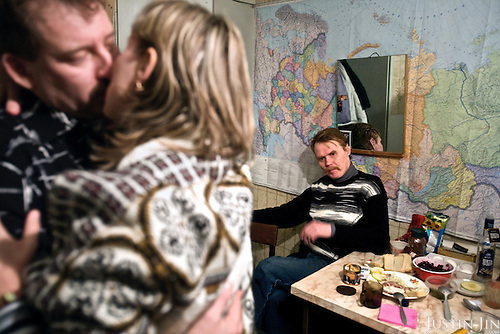 Valery Zhukov, a married miner and union representative in Severny village outside Vorkuta, dances with his lover Lena who lives in the same neighborhood. His friend Alexander is in the back and says he wants the same woman.<br /> Vorkuta is a coal mining and former Gulag town 1,200 miles north east of Moscow, beyond the Arctic Circle, where temperatures in winter drop to -50C. <br /> Here, whole villages are being slowly deserted and reclaimed by snow, while the financial crisis is squeezing coal mining companies that already struggle to find workers.<br /> Moscow says its Far North is a strategic region, targeting huge investment to exploit its oil and gas resources. But there is a paradox: the Far North is actually dying. Every year thousands of people from towns and cities in the Russian Arctic are fleeing south. The system of subsidies that propped up Siberia and the Arctic in the Soviet times has crumbled. Now there&rsquo;s no advantage to living in the Far North - salaries are no higher than in central Russia and prices for goods are higher.