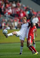 17 September 2011: Colorado Rapids midfielder Jeff Larentowicz #4 and Toronto FC midfielder Eric Avila #8 in action during a game between the Colorado Rapids and Toronto FC at BMO Field in Toronto..Toronto FC won 2-1.