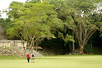 Tourists exploring  the Mayan ruins of Copan, Honduras. Copan is a UNESCO World Heritage Site.