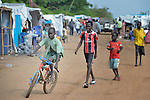 Children play on a street in a camp for internally displaced families located inside a United Nations base in Juba, South Sudan. The camp holds Nuer families who took refuge there in December 2013 after a political dispute within the country's ruling party quickly fractured the young nation along ethnic and tribal lines. The ACT Alliance is providing a variety of services, including fresh water, sanitation and refuse collection services, to the more than 20,000 people living in the camp.