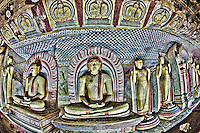 Colorful Buddhas located inside a cave temple. (Photo by Matt Considine - Images of Asia Collection)
