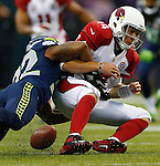 Arizona Cardinals quarterback Ryan Lindley fumbles the ball while being sacked by Seattle Seahawks strong safety Jeron Johnson at CenturyLink Field in Seattle, Washington on  December 9, 2012.  The Seahawks beat the Cardinals 58-0.     UPI/Jim Bryant