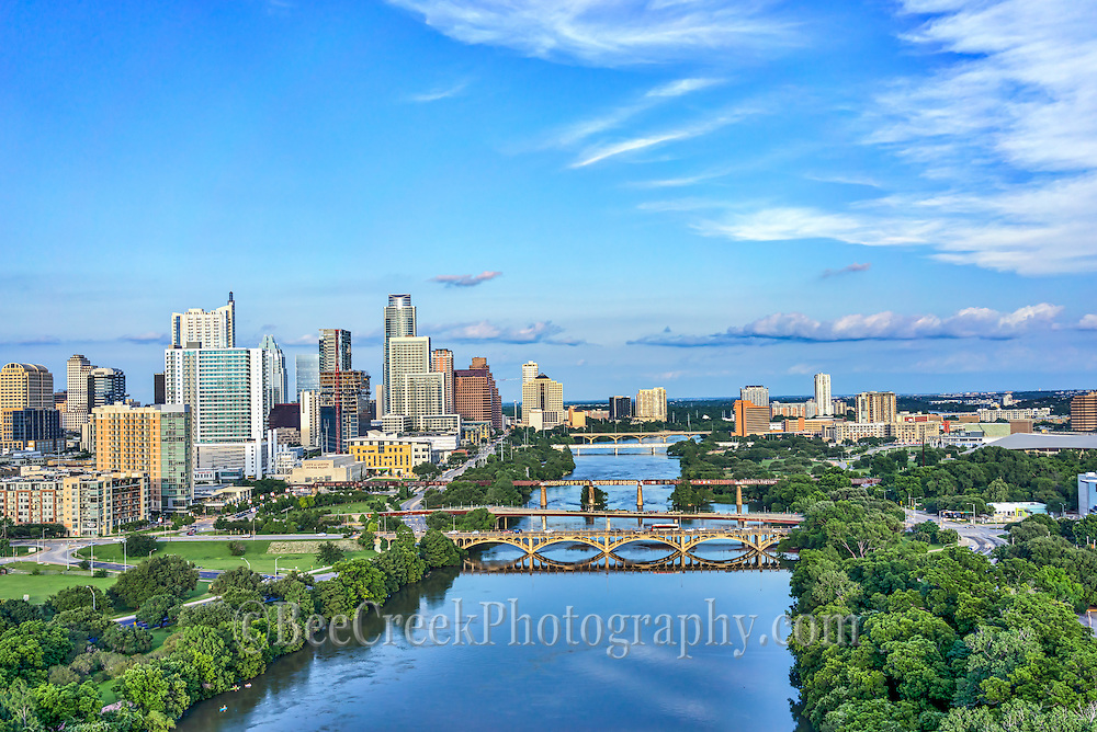This is an aerial captured over the Lady Bird Lake with the Austin skyline in the back ground.  The cityscape of Austin is a modern urban area with many high rise skyscrapers buildings along the downtown shoreline so it make a nice architecture image.  You can also see the many unique architecture high rise city along with the many bridges across the lake