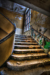 Interior of old tanks barracks somewhere near Berlin with decaying staircase