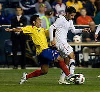 Benny Feilhaber (22) of the USMNT is tackled by John Javier Restrepo (21) of Colombia during an international friendly at PPL Park in Chester, PA.  The U.S. tied Columbia, 0-0.