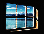 Window in a lakeside hut with a view on the South Island of New Zealand.
