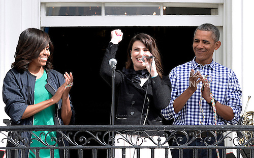 Singer Idina Menzel performs the National Anthem as United States President Barack Obama (R) and first lady Michelle Obama (L) look on during the White House Easter Egg Roll on the South Lawn of the White House March 28, 2016 in Washington, DC. <br /> Credit: Olivier Douliery / Pool via CNP